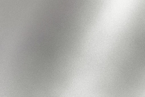 Abstract texture background, light shining on gray metal wall 1141442923