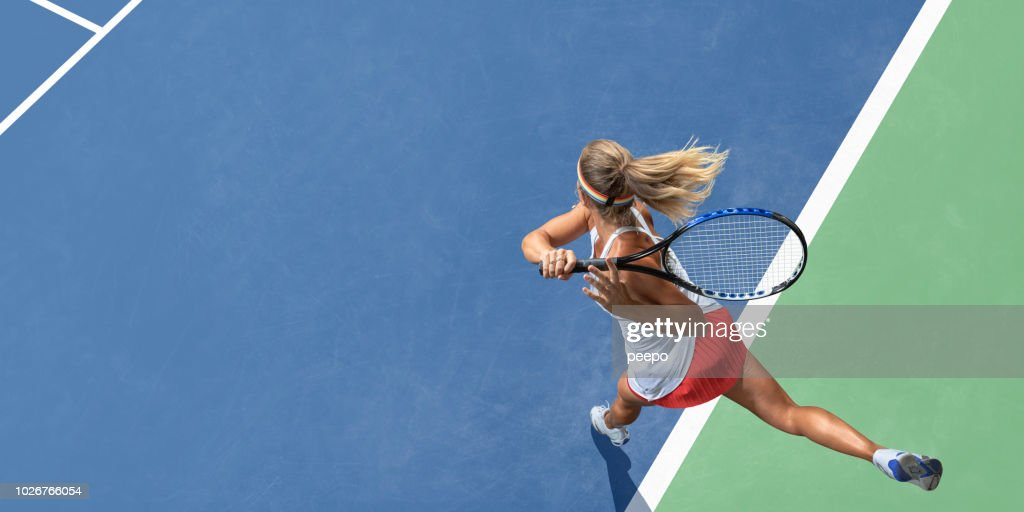 Abstract Top View Of Female Tennis Player After Serve : Stock Photo