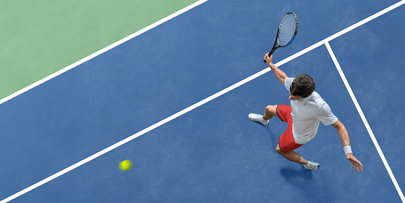 Abstract Top View Of Tennis Player About to Hit Ball 1150479340