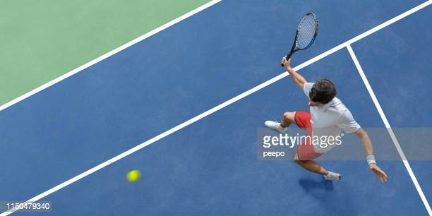 abstract top view of tennis player about to hit ball - taking a shot sport stock pictures, royalty-free photos & images