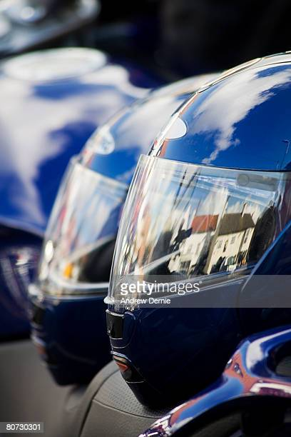 abstract two crash helmets perched on a motorbike seat on race day - helmet visor stock pictures, royalty-free photos & images