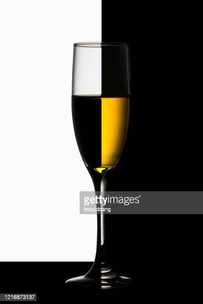 abstract two tone wine glass with red and white wine - two tone color stock pictures, royalty-free photos & images