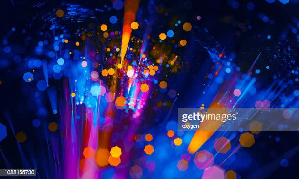 abstract vibrant bokeh sparkling spray circle - bright stock pictures, royalty-free photos & images