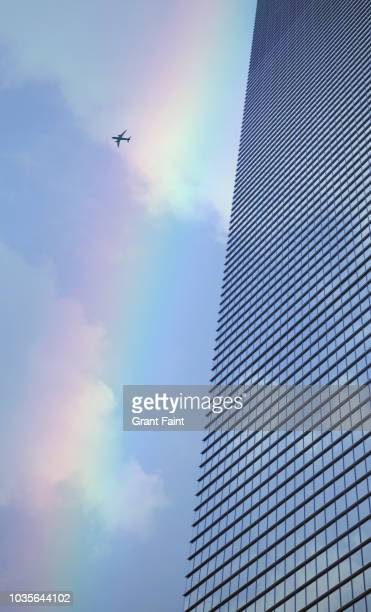 abstract view of office tower and jet. - calm before the storm stock pictures, royalty-free photos & images