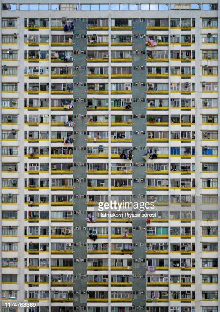 abstract view of residential building facade in hong kong - tower stock pictures, royalty-free photos & images