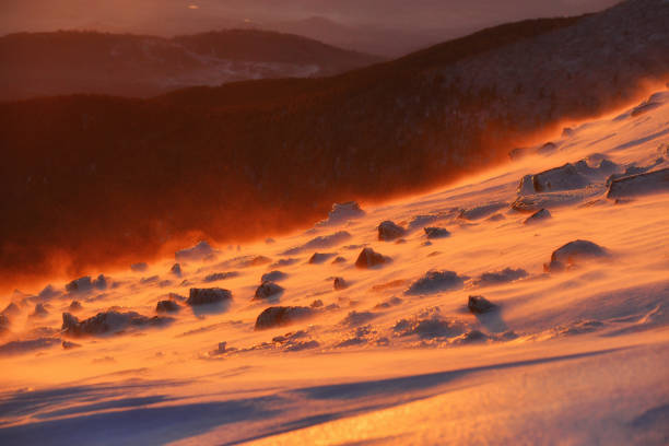 Abstract view of snow blizzard in a mountain at sunrise