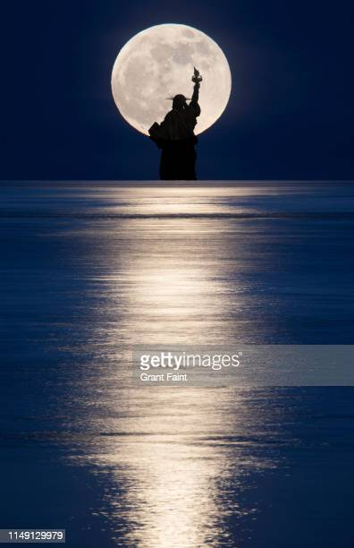 composite image moonrise over ocean with