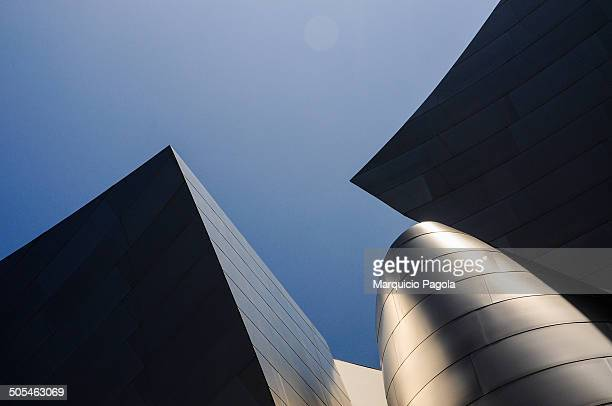 Abstract view of the Walt Disney Concert Hall building in Los Angeles, California, USA. Part of the sky can be seen in the background.