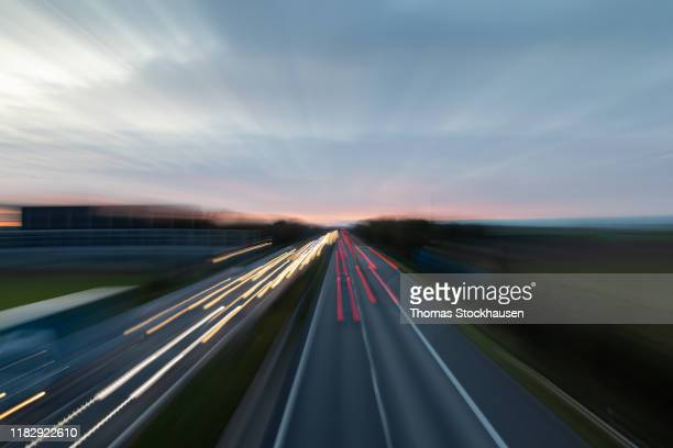abstract view on germany autobahn a61, dawn - 遅い ストックフォトと画像