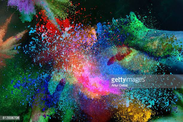 Abstract view with inverted colors of the colorful Holi celebration with powder splash.