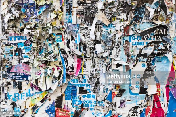 abstract wall texture background filled with stickers - torn stock pictures, royalty-free photos & images