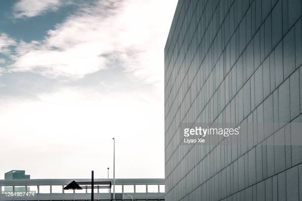 abstract wall under empty sky - liyao xie stock pictures, royalty-free photos & images