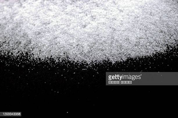 abstract wallpaper design of white color shiny snow dust powder isolated on black background - frost stock pictures, royalty-free photos & images