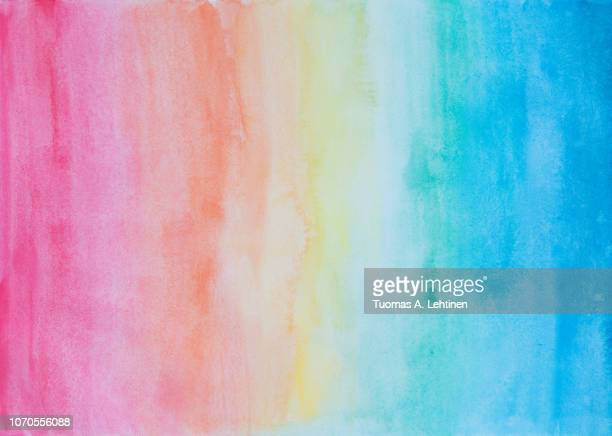 abstract watercolor background in rainbow colors - rainbow stock pictures, royalty-free photos & images