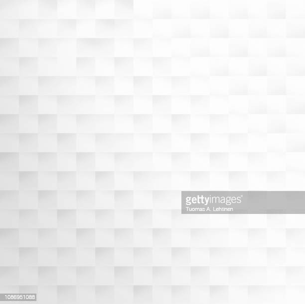 Abstract white and light gray geometric background with squares.