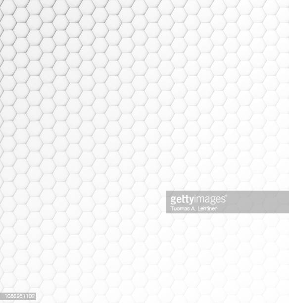 abstract white and light gray hexagonal background with some lightness gradient. - honeycomb stock pictures, royalty-free photos & images