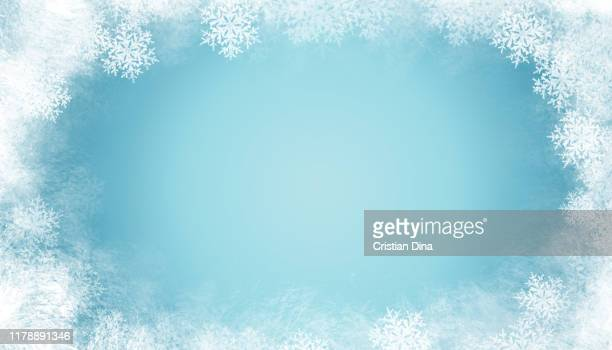 abstract winter background with snowflakes and ice on blue color basic - snowflake background stock photos and pictures