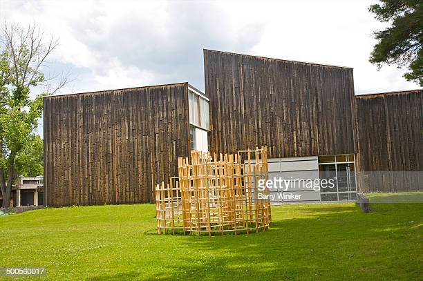 abstract wood sculpture near college building - barry wood stock pictures, royalty-free photos & images