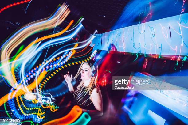 Abstract Young Woman DJ Performance on Stage
