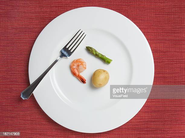 absurdly small diet meal - small stock pictures, royalty-free photos & images