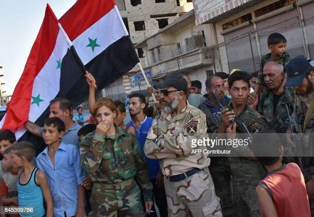 Abu Ali Salhab a general in the progovernment Military Shield forces talks with civilians in the eastern city of Deir Ezzor on September 10 as they...