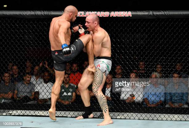 Abu Azaitar of Germany knees Vitor Miranda of Brazil in their middleweight bout during the UFC Fight Night at Barclaycard Arena on July 22 2018 in...