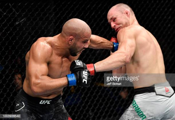 Abu Azaitar of Germany punches Vitor Miranda of Brazil in their middleweight bout during the UFC Fight Night at Barclaycard Arena on July 22 2018 in...