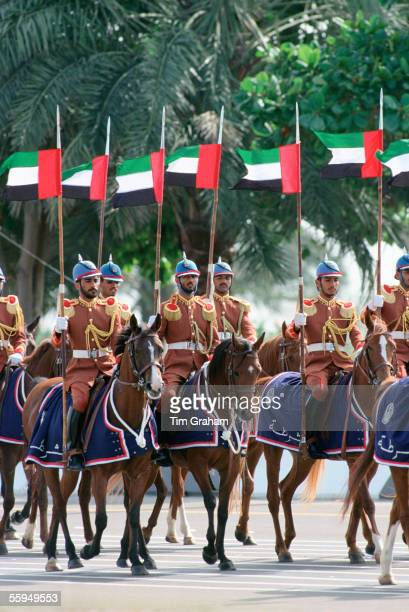 Abu Dhabi army soldiers on horseback in a parade