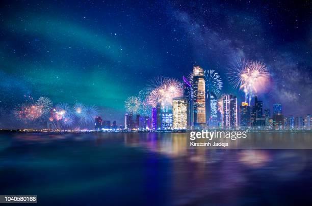 abu dhabi at night with fireworks - 幻想 ストックフォトと画像
