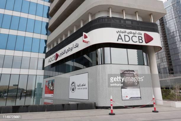 abu dhabi commercial bank (adcb) in dubai, united arab emirates - abu dhabi stock pictures, royalty-free photos & images