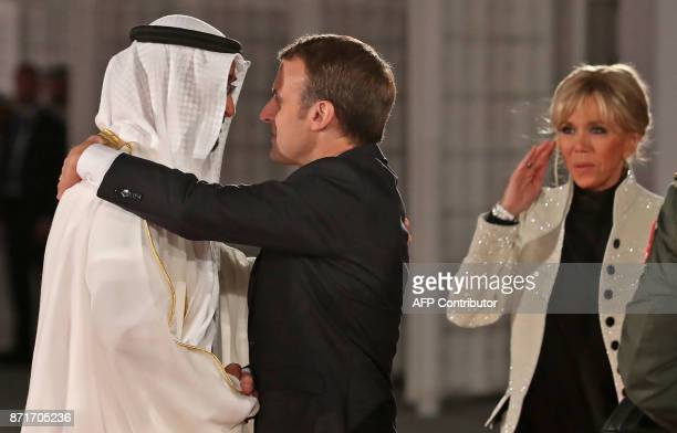 Abu Dhabi Crown Prince Mohammed bin Zayed AlNahyan greets French President Emmanuel Macron and his wife Brigitte Macron at the entrance of the Louvre...