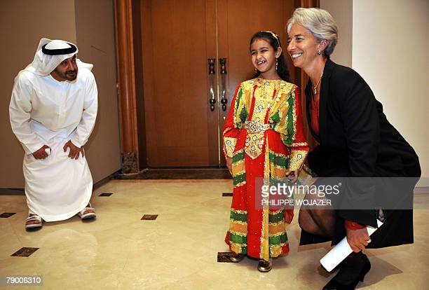 Abu Dhabi Crown Prince Sheikh Mohammed Bin Zayed Al Nahyan encourages his daughter Princess Hassa as she poses for photographers with France's...
