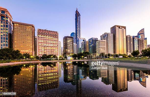 abu dhabi downtown skyline and corniche reflections - abu dhabi stock pictures, royalty-free photos & images