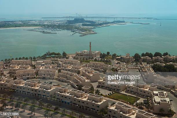 abu dhabi. mosque and arab style homes. - uae heritage stock photos and pictures
