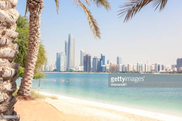UAE, Abu Dhabi, palm, beach and skyline