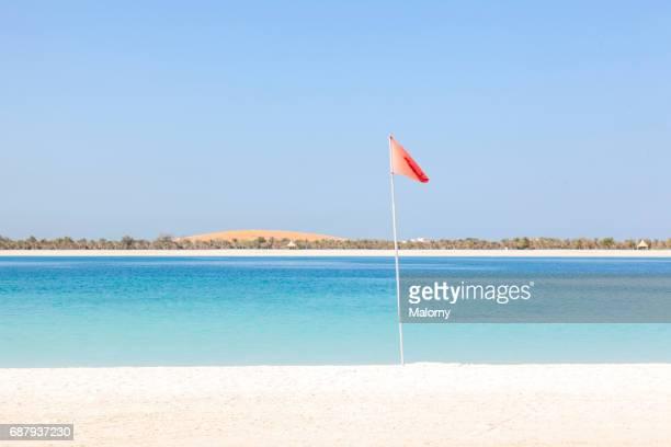 UAE, Abu Dhabi, Persian Gulf, Corniche, beach, red flag at the beach
