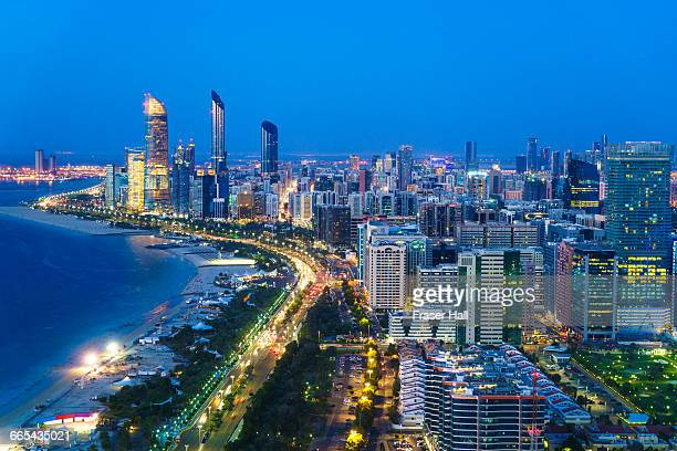 abu dhabi skyline and corniche at night - abu dhabi stock pictures, royalty-free photos & images