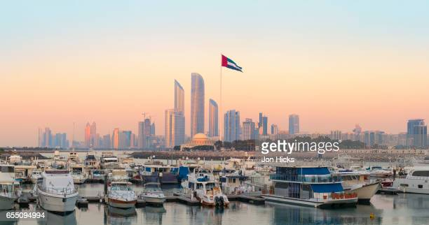 abu dhabi skyline from the breakwater. - united arab emirates flag stock photos and pictures