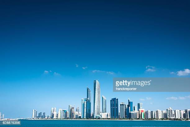 abu dhabi skyline waterfront - skyline stock pictures, royalty-free photos & images