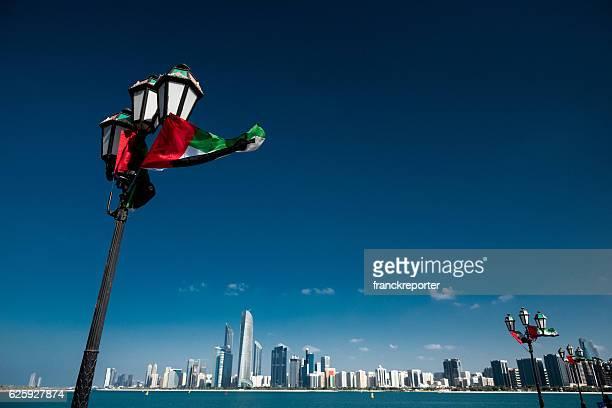 Abu dhabi skyline with national flag