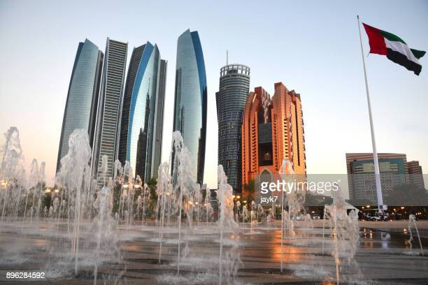 abu dhabi skyscrapers - united arab emirates flag stock photos and pictures