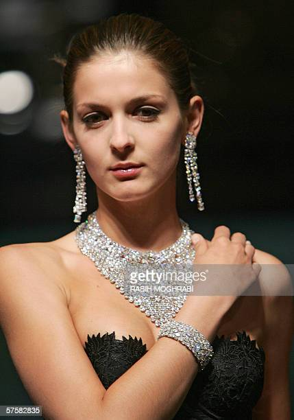 A model displays jewellery by British designer Graff the world renowned diamond jewellery house during the third day of the luxury goods fair known...