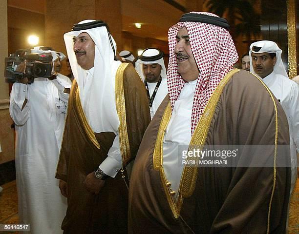 Bahraini Foreign Minister Sheikh Khaled bin Ahmad alKhalifa arrives along with his his Qatari counterpart Sheikh Hamad bin Jassem al Thani to attend...