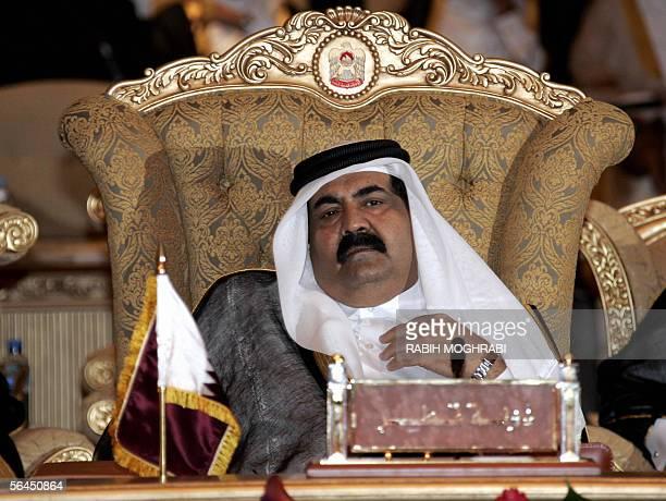Abu Dhabi, UNITED ARAB EMIRATES: Emir of Qatar Sheikh Hamad bin Khalifa Al Thani attends the opening session of the 26th annual summit of the Gulf...
