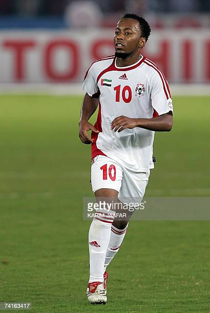Emirati national football team player Ismail Matar runs in the field during the 18th Gulf Cup championship football match between UAE and Oman in the...