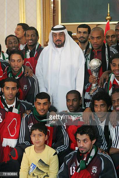 Emirati President Sheikh Khalifa bin Zayed alNahayan poses with the United Arab Emirates national football team at the Presidential Palace in Abu...