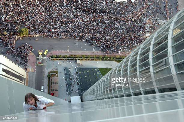 French 'Spiderman' Alain Robert climbs the Abu Dhabi Investment Authority building in Abu Dhabi 23 February 2007 While other famous urban climbers...