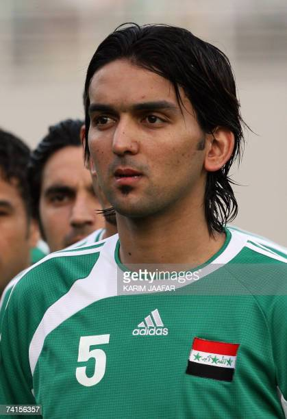 Iraqi football team player Nashat Akram poses before the start of the 18th Gulf Cup championship football match between Iraq and Bahrain in the...