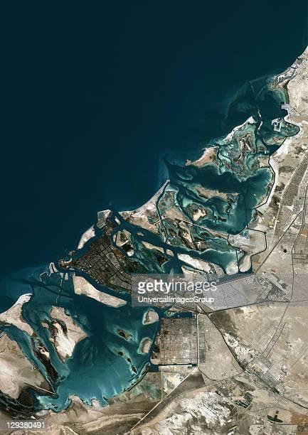 Abu Dhabi United Arab Emirates True colour satellite image of Abu Dhabi the largest of the seven emirates that comprise the United Arab Emirates...