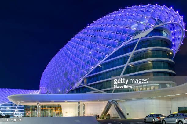 abu dhabi. united arab emirates. yas marina viceroy hotel at dusk - performing arts center stock pictures, royalty-free photos & images